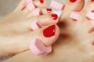 foot pedicure applying red toenails